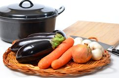 Vegatarian cooking with home grown vegetables. On white royalty free stock photos