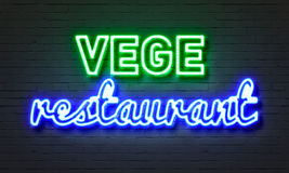 Vege restaurant neon sign on brick wall background. Royalty Free Stock Photo
