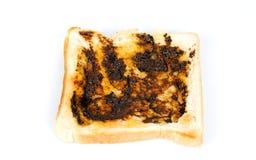 Vegemite on Toast. Australian dark yeast spread on white toast with butter Stock Image