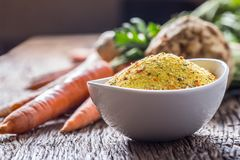 Vegeta seasoning spices condiment with dehydrated carrot parsley celery parsnips and salt with or without glutamate.  Stock Photos