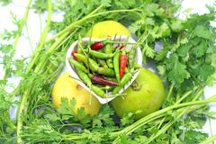 Vegetable. Chili and lemons on parsley Royalty Free Stock Images