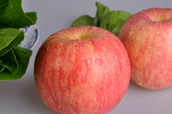 Vegetable and apple. Green vegetable and two fresh red apples Royalty Free Stock Image