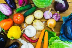 Top view fresh vegetables on the wooden counter of a small vegetable market. Vegetable assortment of different fresh vegetables on a wooden table top view Stock Photography