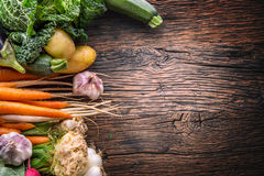 Vegetable. Assortment of fresh vegetable on rustic old oak table. Vegetable from market place.  Stock Photography