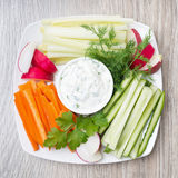 Vegetable assortment and sauce with feta cheese on wood Stock Image