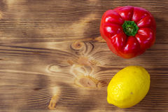 Vegetable background for postcard with red pepper and yellow lem Royalty Free Stock Image