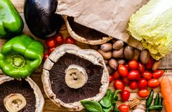 Vegetable background, top view photo of fresh vegetables and black mushrooms close up. stock images