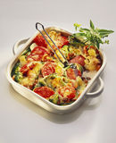 Vegetable bake. With toasted cheese topping, in a baking dish royalty free stock image