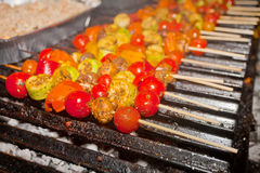 Vegetable barbecue on grill. Vegetable barbecue with meat on skewers on the grill Royalty Free Stock Photos
