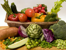 Vegetable basket. A basket overflowing with delicious fresh vegetables Royalty Free Stock Photos