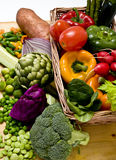Vegetable basket. A basket overflowing with delicious fresh vegetables Royalty Free Stock Image