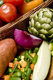 Vegetable basket. A basket overflowing with delicious fresh vegetables Stock Image