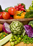 Vegetable basket. A basket overflowing with delicious fresh vegetables Royalty Free Stock Images