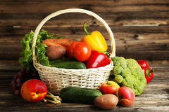 Vegetable in basket on brown wooden background Stock Photos