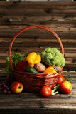Vegetable in basket on brown wooden background Stock Photography
