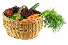 Vegetable basket. A basket full of vegetables on white background Royalty Free Stock Image