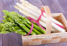 Vegetable basket with green and white asparagus Royalty Free Stock Photo