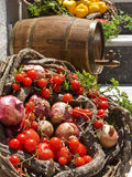 Vegetable Basket and Wine Cask. A pretty display of vegetables and a wine cask. Santorini, Greece royalty free stock photo