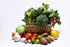 Vegetable baskets. Basketfull of green leafy vegetables and other produce in variety of colors and shapes royalty free stock photo