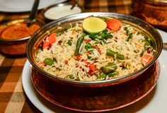 Vegetable Biryani. Biryani, biriani, or beriani is a set of rice-based foods made with spices, rice (usually basmati) and meat, fish, eggs or vegetables royalty free stock image