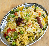 Vegetable Biryani. Biryani, biriani, or beriani is a set of rice-based foods made with spices, rice (usually basmati) and meat, fish, eggs or vegetables stock photo