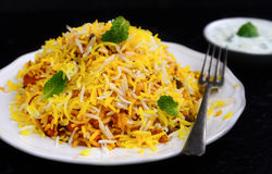Vegetable Biryani. Biryani, biriani, or beriani is a set of rice-based foods made with spices, rice (usually basmati) and meat, fish, eggs or vegetables royalty free stock photography