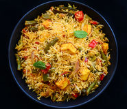 Vegetable Biryani. Biryani, biriani, or beriani is a set of rice-based foods made with spices, rice (usually basmati) and meat, fish, eggs or vegetables like stock image
