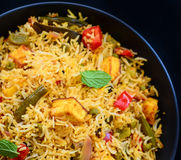 Vegetable Biryani. Biryani, biriani, or beriani is a set of rice-based foods made with spices, rice usually basmati and meat, fish, eggs or vegetables like beans royalty free stock photos