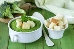 Vegetable broccoli cream soup with white croutons Stock Photos