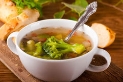 Vegetable broccoli soup and carrots, bread Royalty Free Stock Image