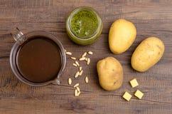 Vegetable broth, pesto, pine nuts and potatoes Stock Photos
