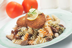 Vegetable burger with pasta Royalty Free Stock Photos