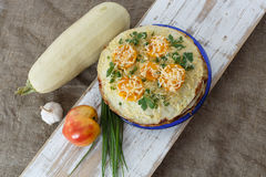 Vegetable cake with zucchini, tomatoes, cheese, onions and garlic served on plate Royalty Free Stock Photos