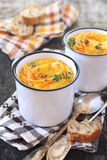 Vegetable carrot soup and bread, two portions. Rustic style royalty free stock photos