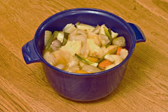 Vegetable casserole. A blue bowl containing a vegetable casserole Stock Photography