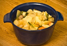 Vegetable stew. A vegetable casserole in a blue bowl Royalty Free Stock Photos