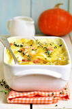 Vegetable casserole from pumpkin,potato and carrot with thyme. Royalty Free Stock Images