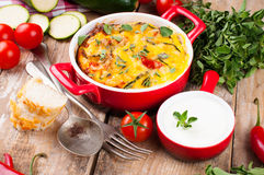 Vegetable casserole in a red pot Royalty Free Stock Photo