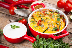 Vegetable casserole in a red pot Stock Image