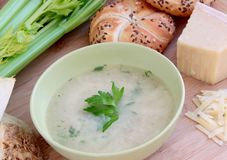 Vegetable celery soup with parmesan cheese and whole grain baguette. Vegetable creamy celery soup served with parmesan cheese and whole grain baguette Stock Images