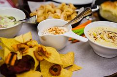 Vegetable chips and different dips Royalty Free Stock Image