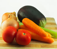 Vegetable on chopping board. Fresh vegetables on wooden chopping board Stock Photo
