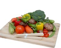 Vegetable collection. Isolated on a Chopping board Royalty Free Stock Photos