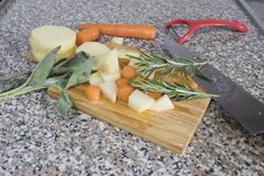 Vegetable composition with potatoes, carrots and spices royalty free stock image
