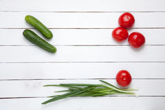 Vegetable composition - tomato, cucumber and green onion. top view Royalty Free Stock Photos