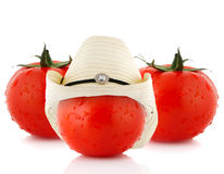 Vegetable concept. Tomato dress a hat, isolated on white Royalty Free Stock Image