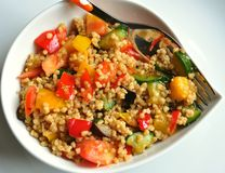 Vegetable cous cous meal. Vegetable cous-cous meal in a white bowl on a white background Stock Image