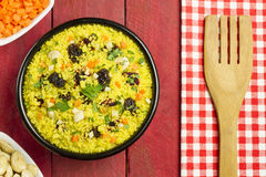 Vegetable couscous in a black bowl Stock Images