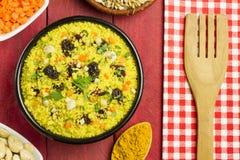 Vegetable couscous in a black bowl Stock Photos