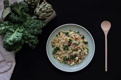 Vegetable couscous dish on dark background. Vegetable couscous in dish on dark background n royalty free stock photos